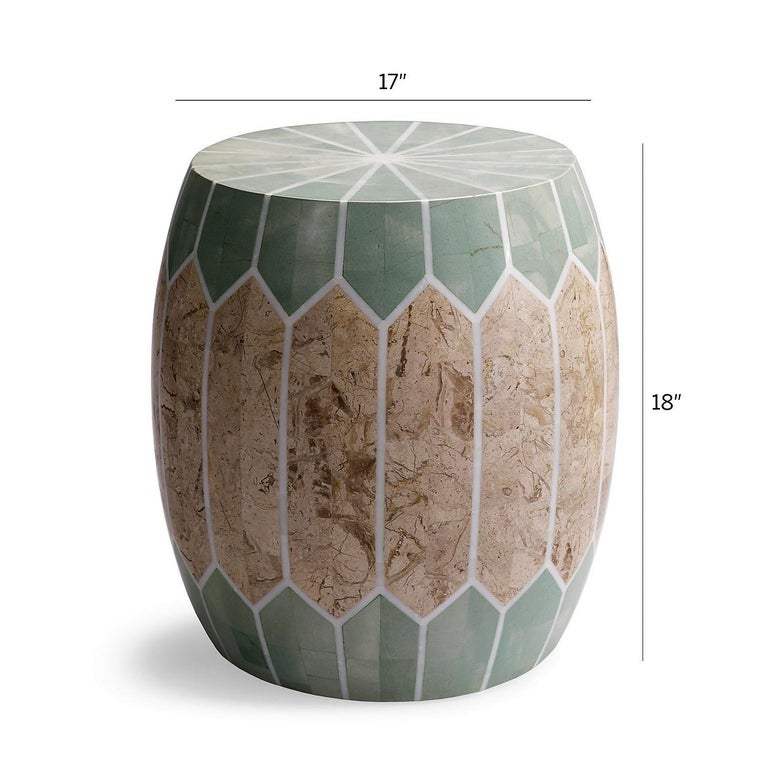 Contemporary stool or side table that is available for indoor or outdoor use. The piece is perfect for next to a sofa or an armchair or as a stool for a seat in an outdoor patio area. The stool is composed of stone and fiberglass and has plastic