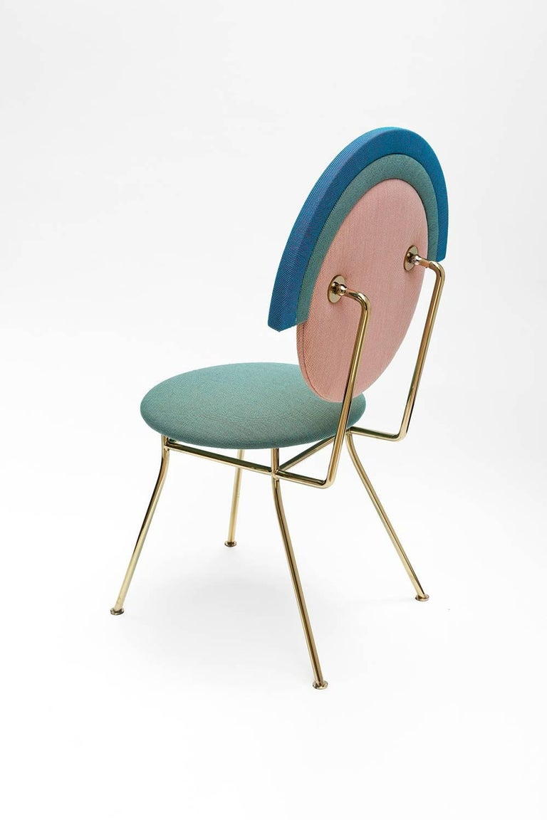In Greek mythology, Iris is the personification of the rainbow and messenger of the gods. Inspired by this rainbow, it is a combination of layers and intentions. This minimal and elegant geometrical shaped chair can fit to any environment thanks to