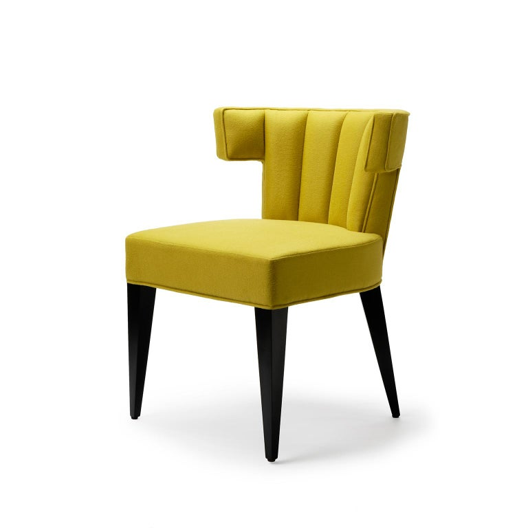 The Isabella dining chair is one of our signature pieces. The dining chair version was one of our first designs and is as highly sought after today as it was when it was first introduced. The exquisite tailored fluting and distinctive lines give a
