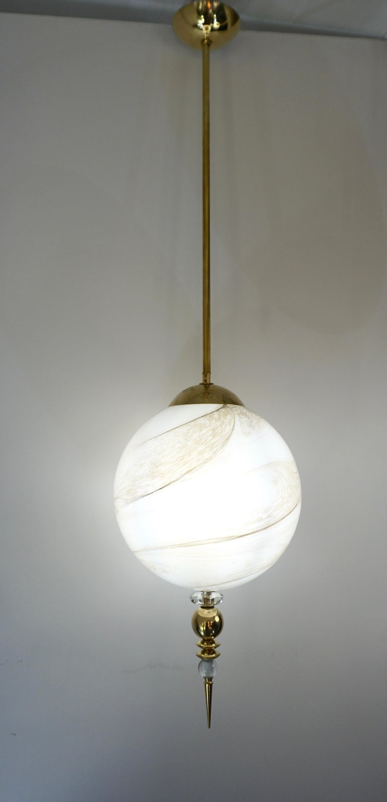 A modern round globe pendant chandelier of a geometric organic series, entirely handcrafted in Italy, the sphere in an innovative blown Murano glass to resemble alabaster with the benefit to be lighter and to remain over time of the same translucent