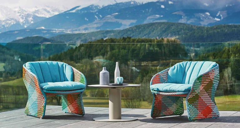 A set of two outdoor lounge chairs crafted in Italy. Powder-coated aluminum frame  Handmade synthetic fiber weave. Cushions with draining Dryfeel® foam padding Weatherproof and UV light resistant structure. Color weaving with sky blue