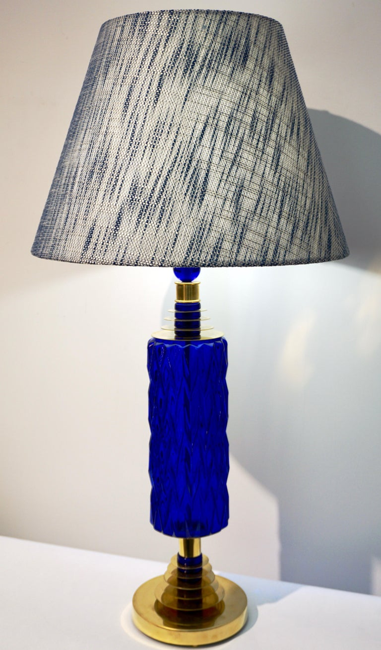 A tall modern pair of blown beehive Murano glass lamps, high quality of craftsmanship, organic design with blown royal blue bodies, preciously decorated with a diamond cut pattern and supported by hand made brass stepped accents interspersed with