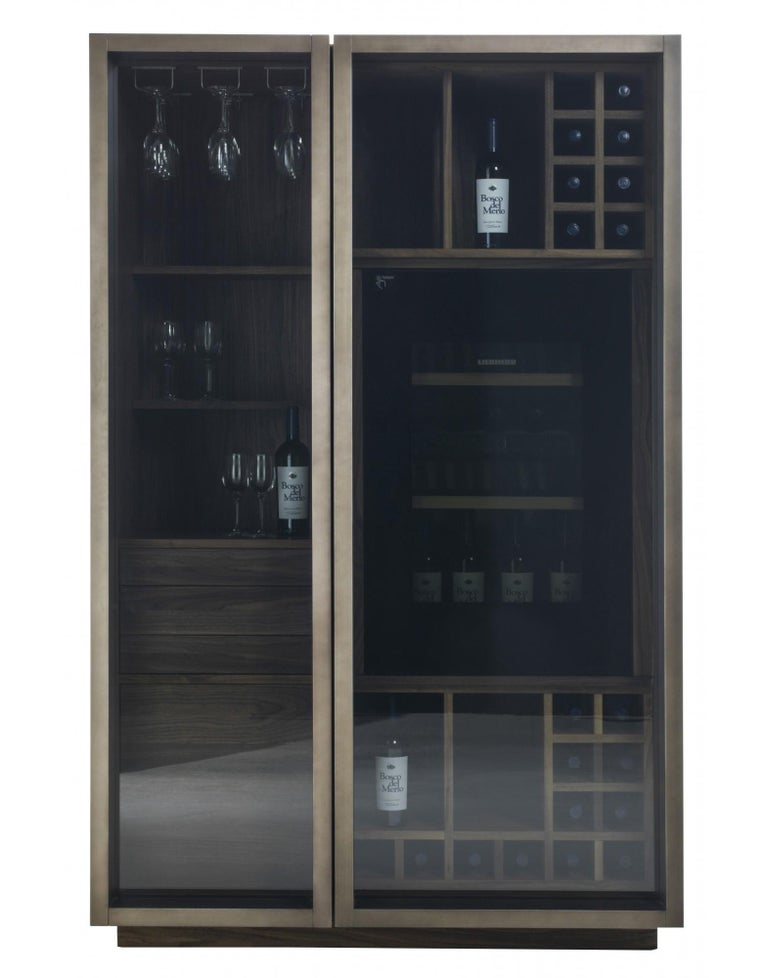 multifunctional storage unit with double glass doors, with plinth and solid wood drawers assembled with dovetails joints and solid wood push-pull opening system.   Unit and inner structure fittings are designed to meet container and functional