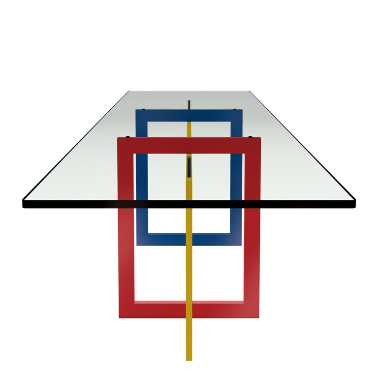 The high Jonathan table features a tubular metal 20 x 60 mm frame, epoxy coated in glossy red, blue and yellow colors in the