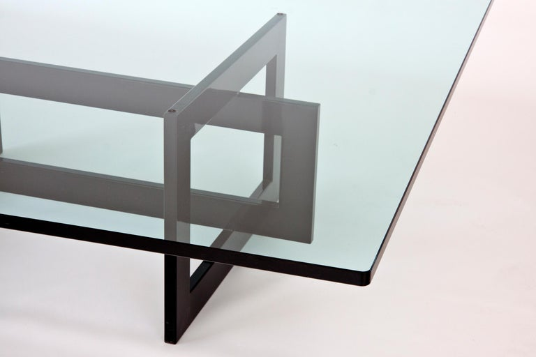 The low Jonathan table features a tubular metal 20x60mm frame, epoxy coated in glossy black color. Variable colors for the frame upon request. The crystal top makes possible to see the whole frame in all its peculiarity like a