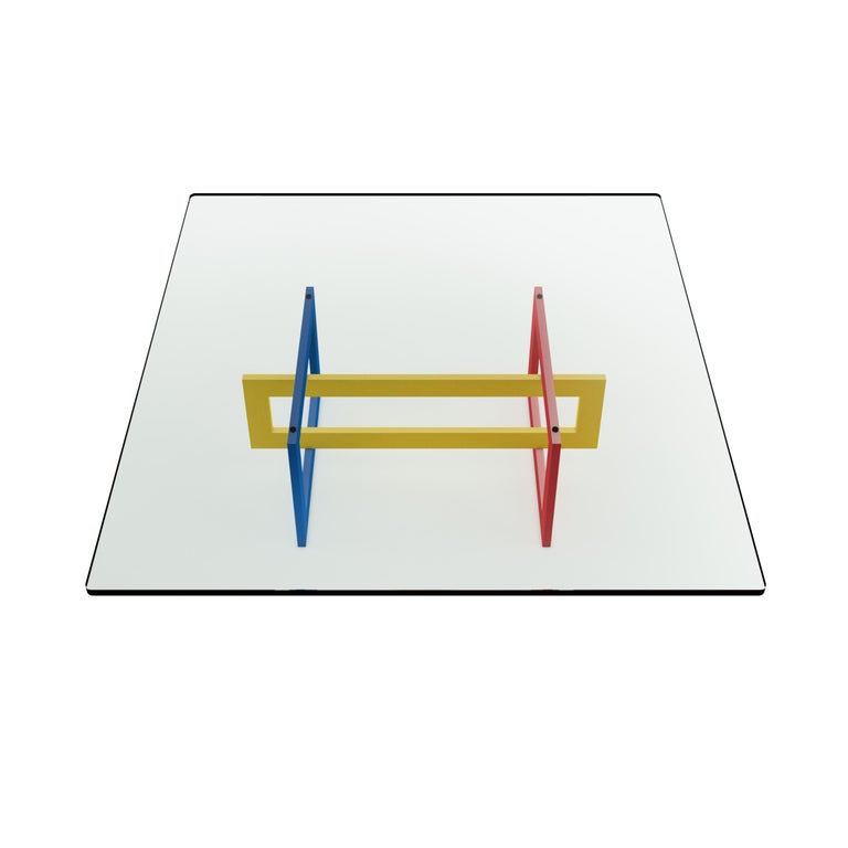 The low Jonathan table features a tubular metal 20 x 60mm frame, epoxy coated in glossy red, blue and yellow colors in the