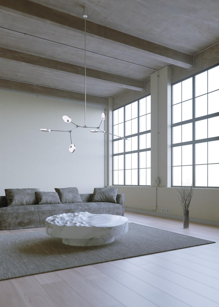 Taking inspiration from the necessity of light for life, the Joni range is a portrayal of photosynthesis, the process by which plants convert sunlight to food.   Within each leaf-like LED light structure, a crystal hemisphere magnifies an