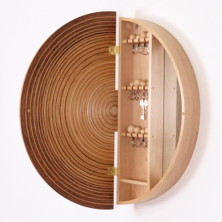 The contemporary Luna key cabinet by Edward Johnson forms part of his Murano Collection.  The Luna key cabinet is made using Edward Johnson's unique circular and semi-circular 'Murano' veneers that have been developed and produced in his workshop.