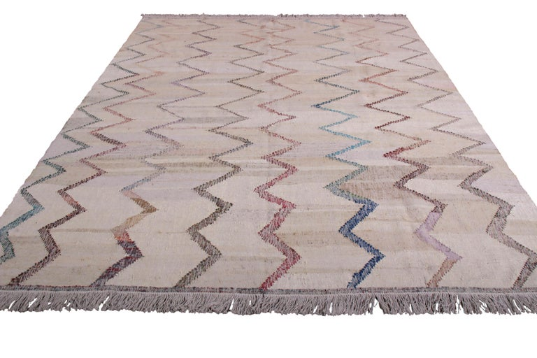 This contemporary Kilim represents a selection of distinct new patterns joining Rug & Kilim's New and Modern collection, uniquely handwoven from the yarns of Classic textiles and Kilims to create this transitional flat-weave and its lively, varied