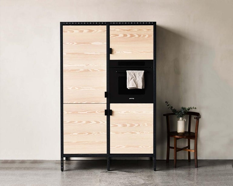 Contains: One oven, one fridge / freezer, one cupboard large with two shelves, one cupboard small. Frama Studio Kitchen is designed to be a free standing element in a space without mounting to any walls or floors. The Frama Kitchen portrays the