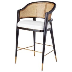 Contemporary Lacquered Rattan Barstool With Brass detailing.