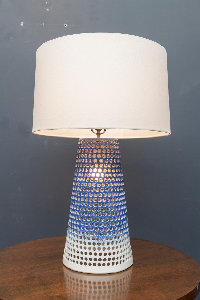 Elegant large ceramic lamp designed by Ryan Mennealy 2012, signed. Double sockets that can be turned together or illuminated separately.