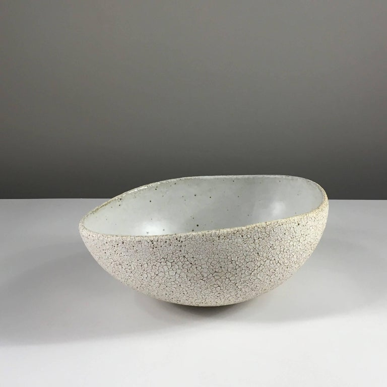 Contemporary ceramic artist Yumiko Kuga's glazed stoneware large bowl no. 119 is part of her Crackle Series. All of the pieces in this series are hand-built and 100% handmade so they are one-of-a-kind and thus vary slightly from one another. All