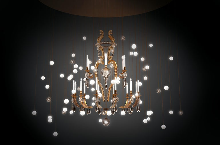 The Bespoke chandelier Le Merveilleux – Le Black is designed by Sylvie Maréchal and by Jean Delisle and it is entirely manufactured in France. This chandelier is made in bronze and has 17 spheres in mouth blown glass, 64 spheres in handmade Limoges