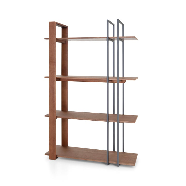 The Lim bookcase features mixed materials and is stocked in both walnut and teak. The design, functionality, and size allows the Lim to be a statement piece wherever you need to locate it. Showpiece. Bookcase. Storage, etc. Lim is a great addition