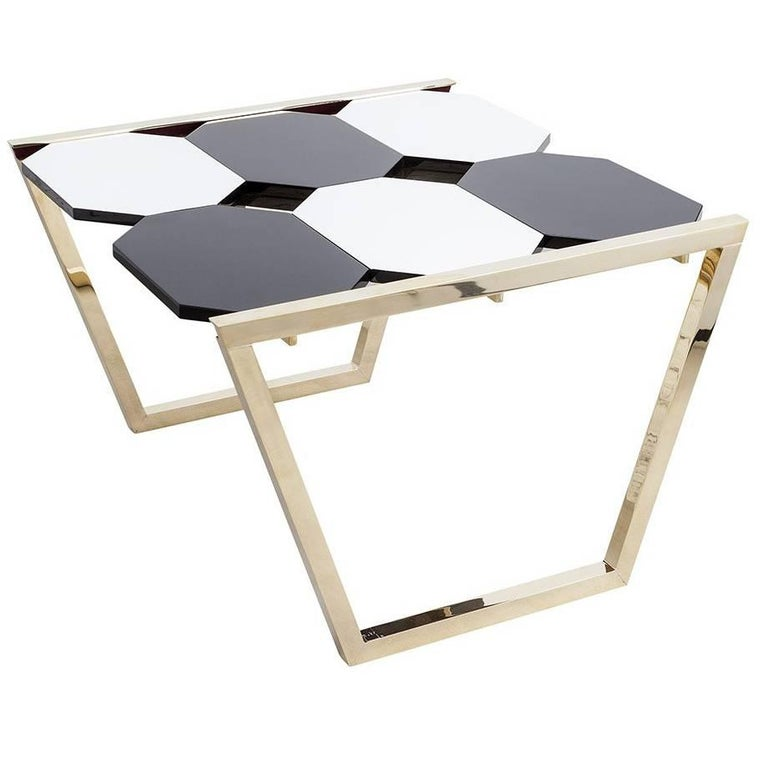 Functional aesthetics: Clean lines of the structure in polished brass and extractable, octagonal forms make this table unique. With chess you can create different patterns of the tabletop through the extractable forms with its solid and bicolor