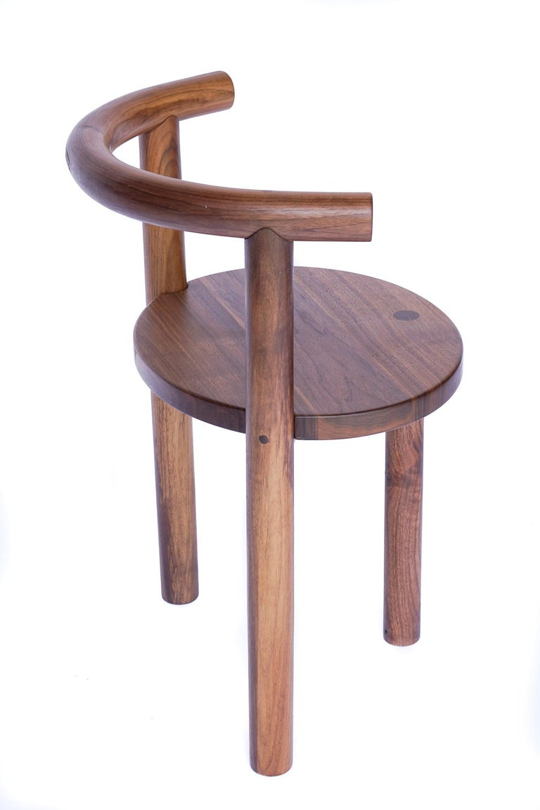 Constructed from solid hardwood, the Macaroni chair playfuly challenges the inviolable qualities wood is known for. The back and armrest is bent from a single piece of wood and cupped by the leg, and finished with unconventional joinery details.