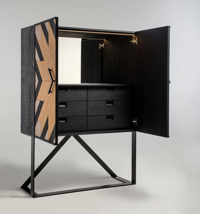 Cabinet designed by Larissa Batista   Handcrafted in Brazil  Material: plywood veneered with different natural woods in matte black, white and natural oak) Door pulls in metal Features a back mirror and LED lightning Hardware: Door damping