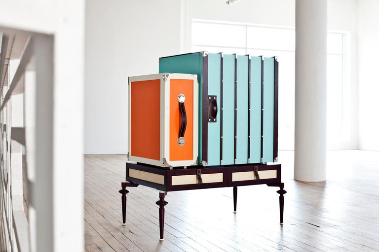 Small minibar cabinet in wood, lacquer and metal legs with mini fridge, liquor cabinets, and a base large drawer.