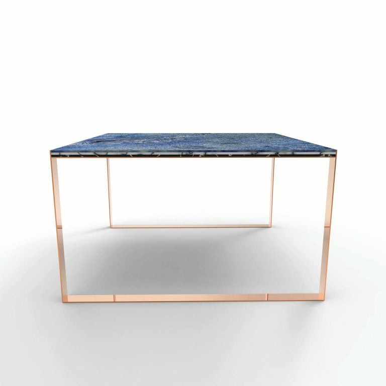 """The """"MARBELLOUS"""" dining table is square shaped table with a simple copper structure and a three layered marble top. Three different sheets of marble - black (Nero Marquina), white (Bianco Carrara) and blue (Azul Baia) - that provide the customer the"""