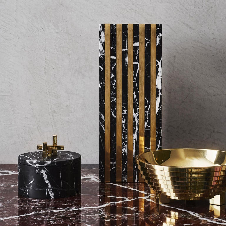 Purity of form and a flash of glamour. The round Metropolis box in Nero stone with its elegant polished brass handle serves as the perfect gift or keepsake.   Dimensions: D 110 x 62 H mm Materials: Nero marble, brass  Marble is a naturally