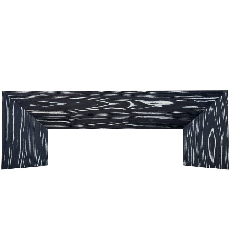 Perfect for a foyer or the end of a bed, the contemporary minimal lined, black and white, Fold Bench is easily adapted to any space. The Fold Bench began as an experiment in creating a 3D object from a two dimensional plane of paper. This