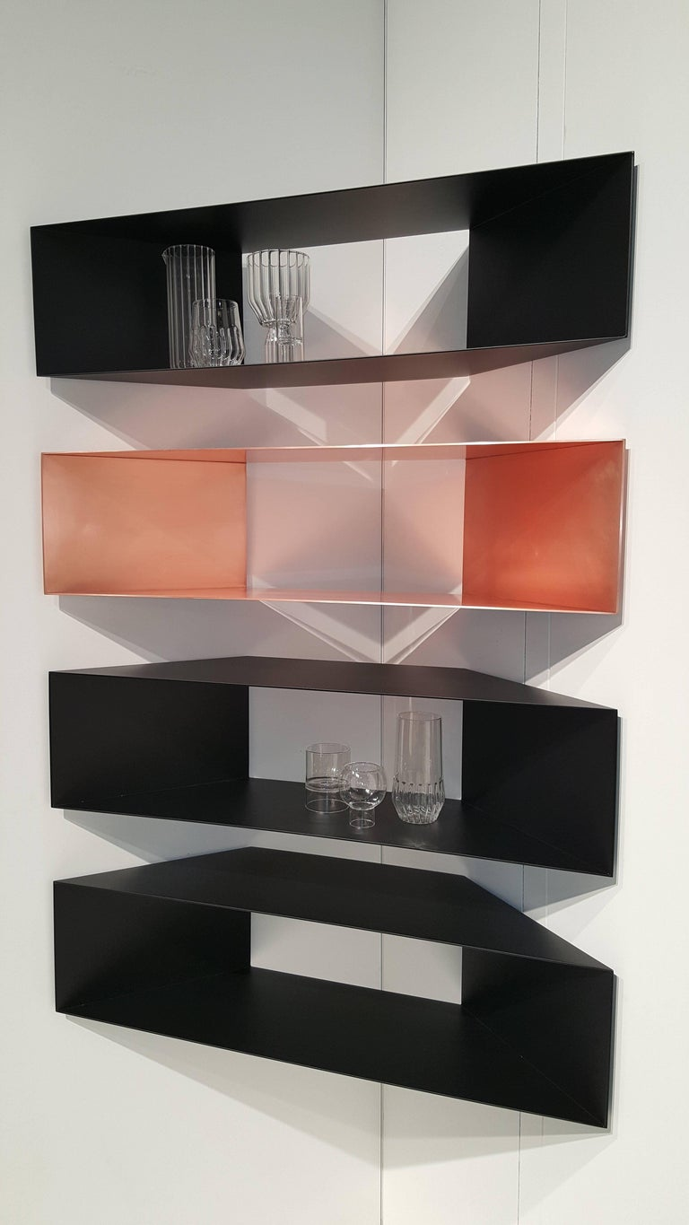 This contemporary sculptural single copper metal minimal corner shelf is perfect for any space be it a living room, office, or bathroom.  In stock: These Minimalist copper shelves, whether installed individually or in a series, occupy a space in a