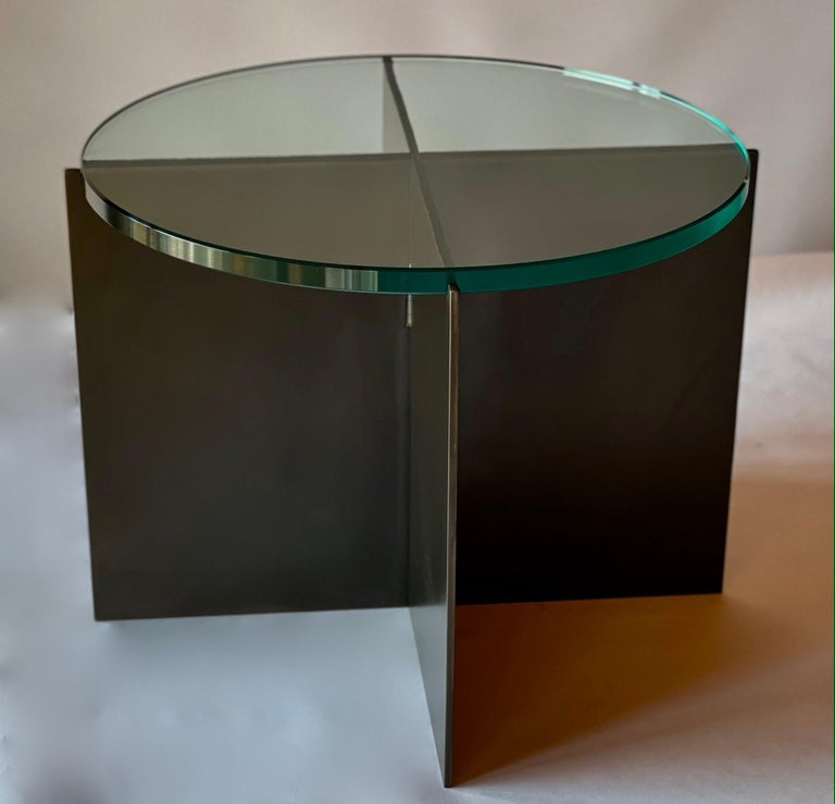 The Crux Cocktail Table, an original design offered exclusively by Vermontica, is a contemporary Minimalist blackened steel and glass side table designed and produced in Vermont by Scott Gordon. The base is made from 1/4