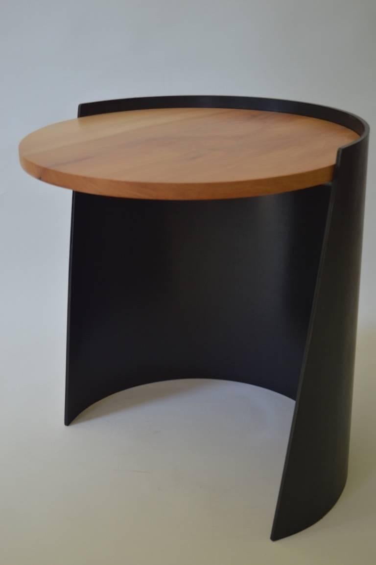 The Cylindrical Side Table, an original design offered exclusively by Vermontica, is a contemporary Minimalist blackened steel and wood side Table designed and produced in Vermont by Scott Gordon. The base is cut from a 1/4