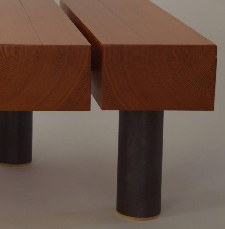 The Cantilevered Coffee Table, an original design offered exclusively by Vermontica, is a contemporary minimalist coffee table designed and produced in Vermont by Scott Gordon. The douglas fir beam sections are joined to patinated steel tubing and