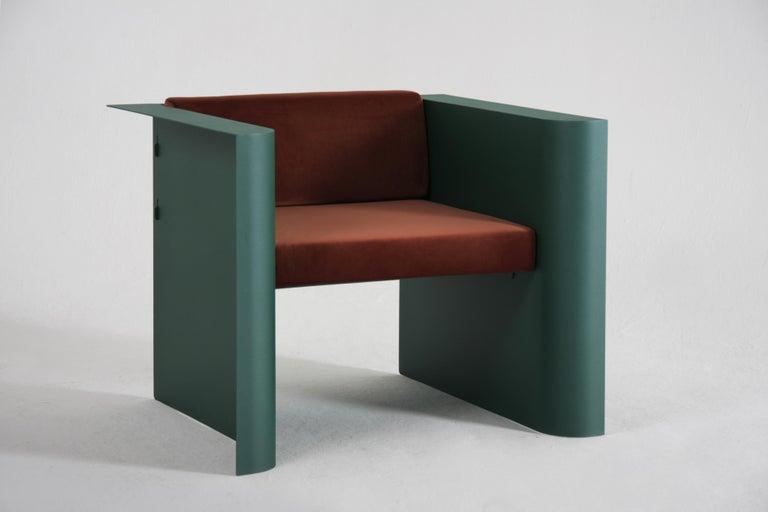 This elegant and minimalistic armchair was designed as an addition for