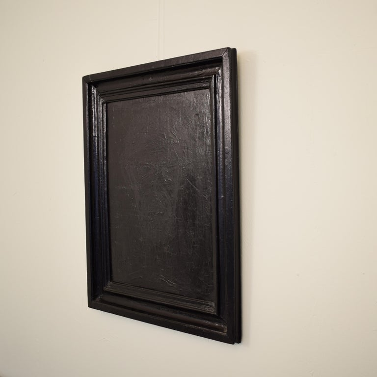 This black painting has heavily textured acrylics on canvas. The artist created the piece using multiple techniques like palet knife, brush and chalk. It is in an old 19th century picture frame. The painting would complement a modern interior