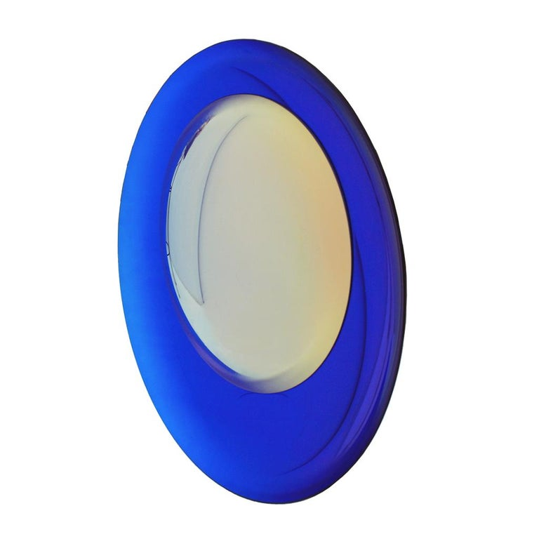 Modern sculptural beautiful concave French mirror. Wall hanging artwork handmade in blue night molded glass and a yellow lens. Finished with brass final details on the back to hang on the wall. Unique piece. Made in France.  Our main target is