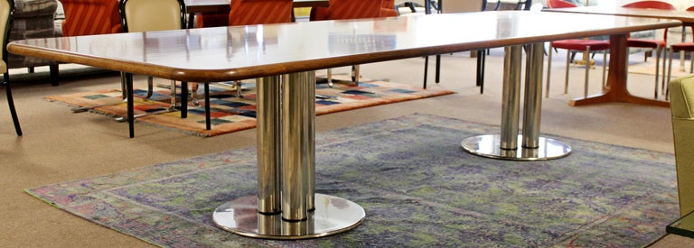 For your consideration is a marvelously massive, walnut topped conference or dining table, on a Pace style base, circa 1980s. In excellent vintage condition. The dimensions are 144