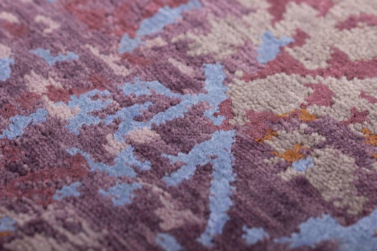 A beautiful hand-knotted oriental rug with contemporary modern design. This lilac, blue, grey and rose colored rug is astonishing because of it´s elegant modern design. On the background color, the motives shine out. It flows between warm and cool