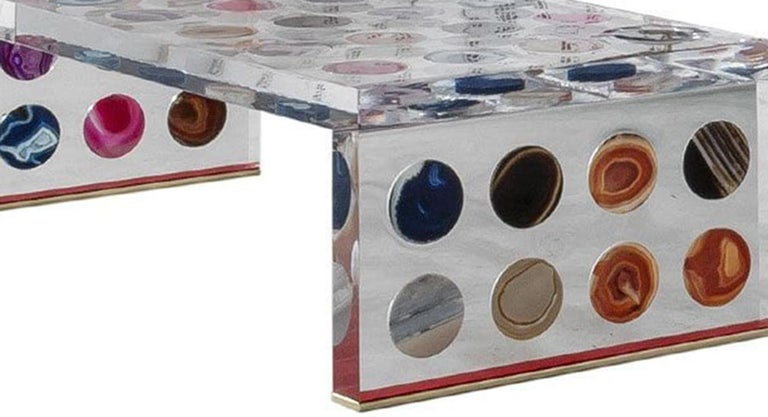 A stunning rectangular shape coffee table designed by Milanese Studio Superego. Made in plexiglas of ten centimeters thickness and surface inlaid decorated with agates. Brass finials on feet. Edition 1/1, Italy.  Our main target is customer