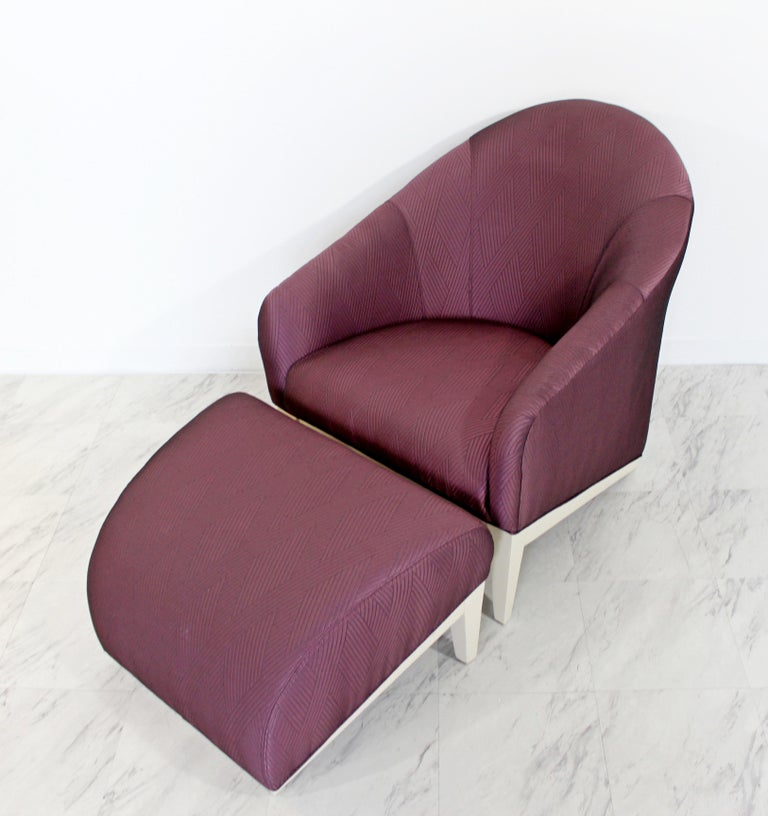 For your consideration is a unique, lounge armchair and matching ottoman. Upholstery is a beautiful purple raw silk. In excellent condition. The dimensions of the chair are 27