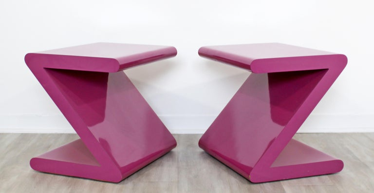 For your consideration is an absolutely fabulous pair of pink, Z-shaped acrylic side or end tables, circa 1980s. In excellent condition. The dimensions are 20