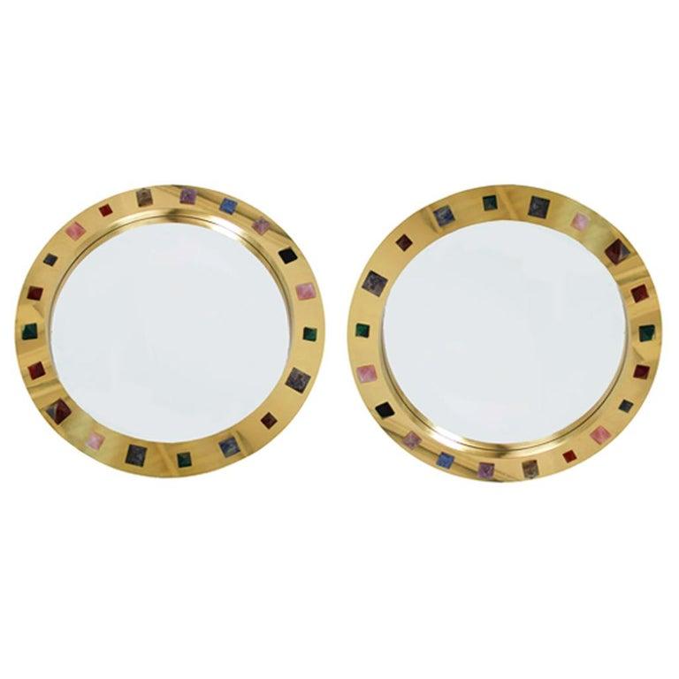 Modern circular Spanish mirror designed by L.A. Studio. Made of brass frame with pyramidal semi precious stones inlaid, such as pink quartz, black quartz, white quartz, tiger eye and malachite.