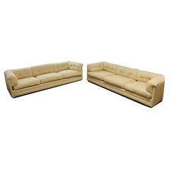 Contemporary Modernist Pair of Tufted Cream Directional Sofas, 1980s