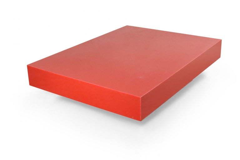 Contemporary modernist low rectangular red lacquered coffee table on a smaller rectangular lucite base.