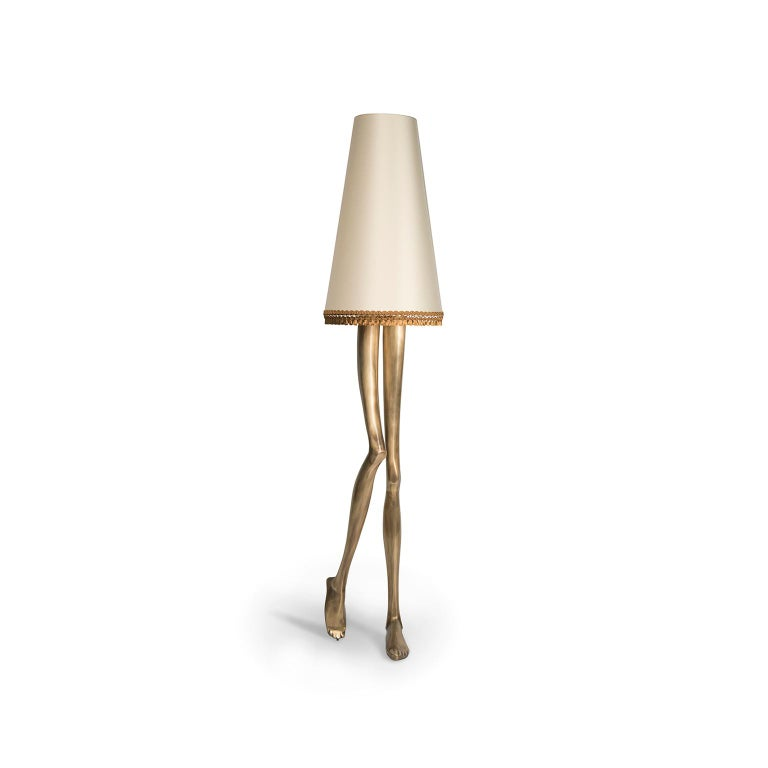 Inspiration:  Marilyn Monroe, the sexiest pin-up of the 1950s, inspired a piece of Art & Design. The design of the Monroe lamp captures the essence of her image and the sensuality of her legs. The lampshade and the gold tassel fringe complement the