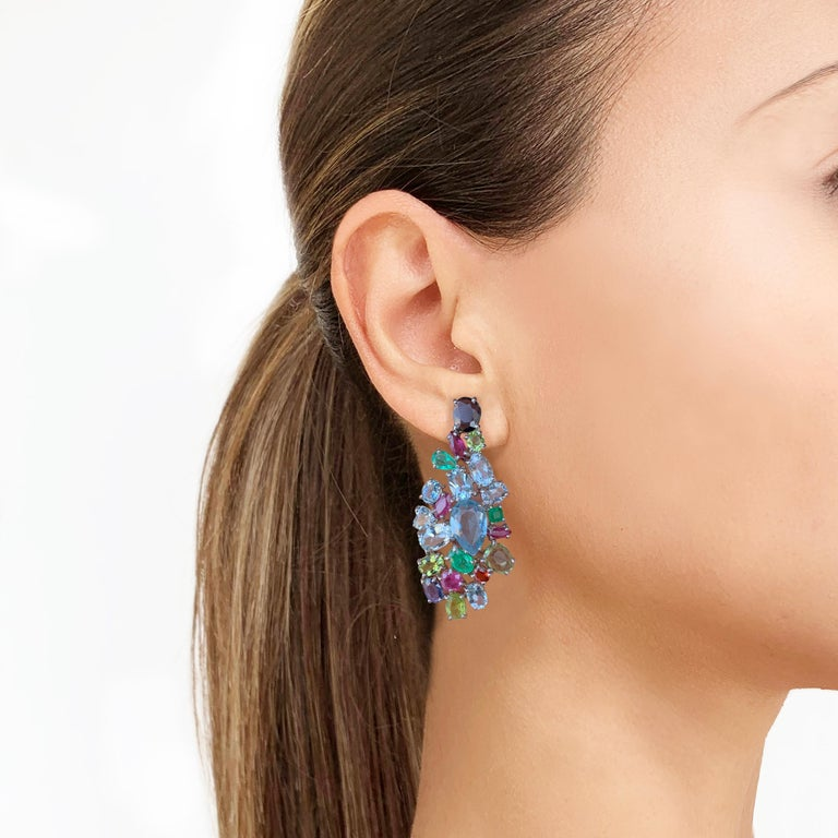 Rosior Contemporary Drop Earrings manufactured in 19.2 Karat White Gold and setted with: - 17 Aquamarines with 14,15ct,  - 1 Iolite with 0,69ct; - 5 Peridots with 2,59ct; - 3 Blue Sapphires with 1,03ct; - 1 Orange Sapphire with 0,20ct; - 6 Emeralds