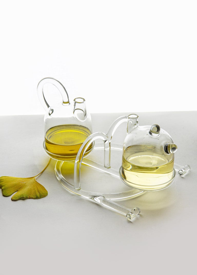 Oil & vinegar from SiO2 Tableware collection   Two small cruets suitable for holding condiments such as Oil and Vinegar. The base with its large handle allows you too easily carry the pair of cruets.  Part of the SiO2 tableware collection, it