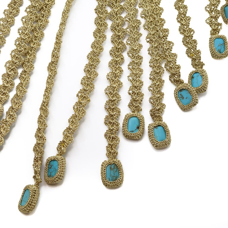 This is a one of a kind contemporary crochet necklace. It is a statement piece. The stones are 16x12mm Turquoise. It is hip and fresh and very unique.  The necklace is crochet with a smooth passing thread. It is a cotton thread coated with a gold