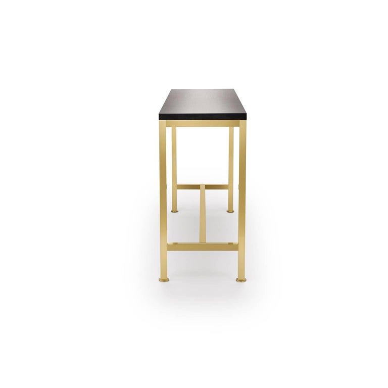 The Orichal range is perfectionist in its simplicity featuring a precision engineered solid brass frame with a top in either oak or walnut.  Shown here: in black lacquered walnut and brushed brass. The frame is precision engineered from solid