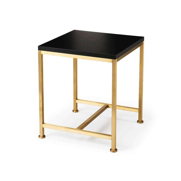 The Orichal range is perfectionist in its simplicity featuring a precision engineered solid brass frame with a top in either oak or walnut. Shown here in black lacquered walnut and brushed brass  Each Stuart Scott piece is built by hand in our