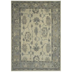 Contemporary Oushak Rug with Floral Patterns in Blue and Gray on Ivory Field