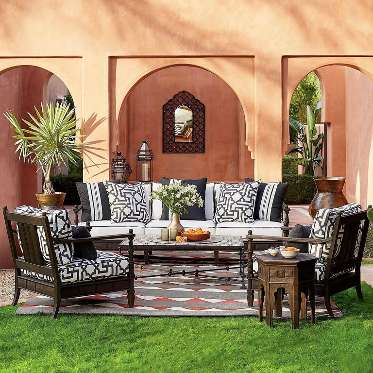 Moroccan style outdoor grade-A teak lightly distressed with a wire brush and finished with an ebony wash. Handcrafted from grade-A teak Wood is treated to resist Expansion and shrinkage Lightly distressed and finished with an ebony