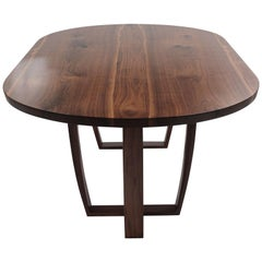 Contemporary oval dining table in book matched American black walnut. Bespoke.